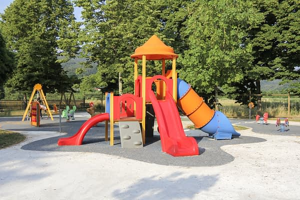 Children's school playground with slides and swings